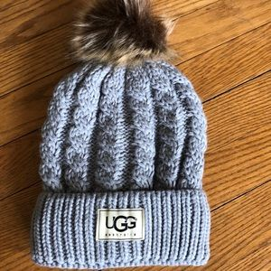 Pale gray cable stitch hat with Pom Pom